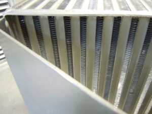 Aerospace style coolers, which are a welded plate and bar construction