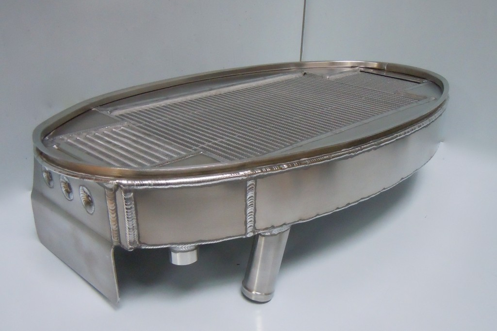 Combined oval oil and water radiator